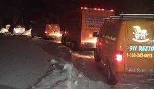 Water Damage Restoration Vans At Snowy Job Location