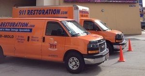 Mold Damage Restoration Vans At Job Location