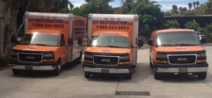 Water Damage Restoration Van And Trucks At Job Location