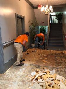 Technicians Renovating A Floor After An Indoor Flood