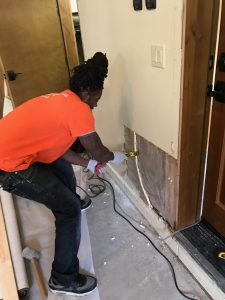A Technician Performing Flood Damage Restoration